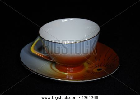 coffee cup and saucer on a black background poster