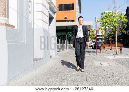 Portrait of business woman walking outdoor
