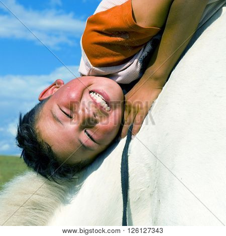 Mongolian Boy Horse Affectionate Embracing Concept
