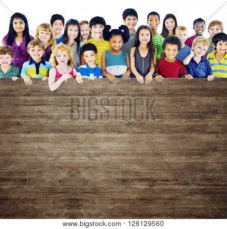 Multi-Ethnic Group of Children Holding Empty Billboard