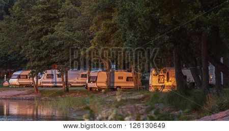 RAUMA, FINLAND ON JULY 01. View of a Camp, Camping grounds along the seaside on July 01, 2013 in Rauma, Finland. Caravans and Campers by the seaside. Editorial use.