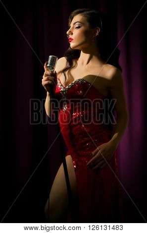 Retro style woman singer with microphone