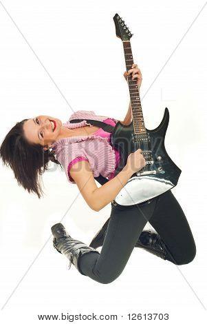 Smiling Young Woman Playing Rock Guitar