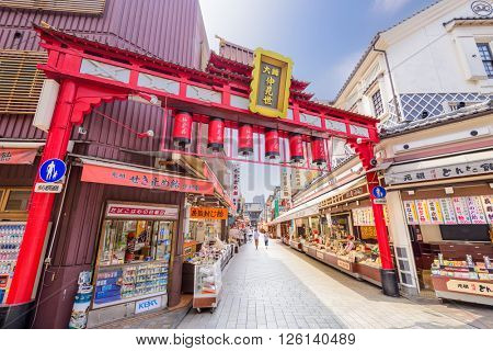 KAWASAKI, JAPAN - AUGUST 7, 2015: Visitors walk down the shopping arcade leading to Kawasaki-daishi Temple founded in 1128.