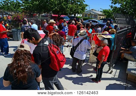 DELANO, CA - APRIL 17, 2016: United Farm Workers members and supporters gather at the Our Lady of Guadalupe Church prior to marching for agricultural workers' rights.