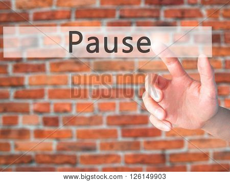 Pause - Hand Pressing A Button On Blurred Background Concept On Visual Screen.