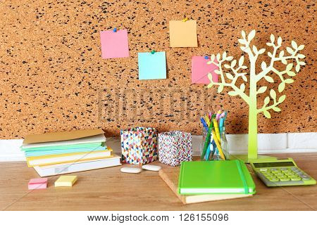 Stationery on light wooden table.