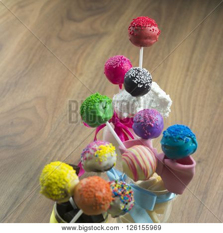 Cake pops sweet soft food made from a mixture of flour shortening eggs sugar and other ingredients baked and often decorated