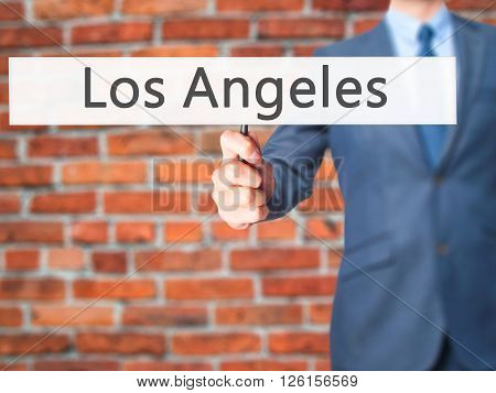 Los Angeles - Businessman Hand Holding Sign