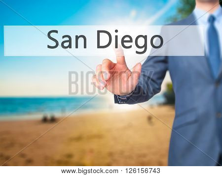 San Diego - Businessman Hand Pressing Button On Touch Screen Interface.