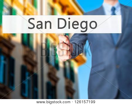 San Diego - Businessman Hand Holding Sign