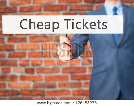 Cheap Tickets - Businessman Hand Holding Sign