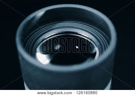 Lens of eyepiece with rubber eyecup. Selective focus. Macro. Close up view. Vintage photo toning.