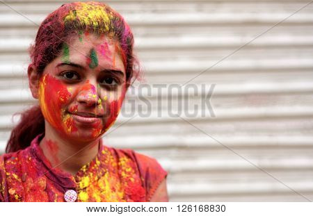 HYDERABAD,INDIA-MARCH 24: Portrait of a Hindu woman celebrating Holi festival smearing colored powder a tradition on March 24,2016 in Hyderabad,India