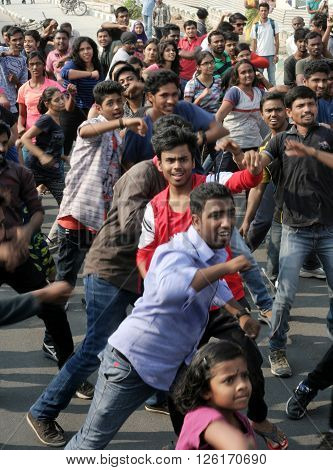 HYDERABAD,INDIA-MARCH 27:Indian young people dancing on open road event on Sunday morning, celebrating World theater day on March 27,2016 in Hyderabad,India.