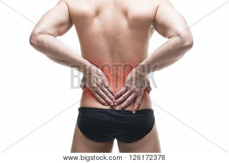 Man with backache. Muscular male body. Handsome bodybuilder posing in studio. Isolated on white background with red dot. Middle part of the body