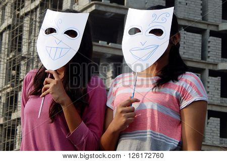 HYDERABAD,INDIA-MARCH 27:Indian young adult wear theatre masks during raahgiri open road event on March 27,2016 in Hyderabad,India