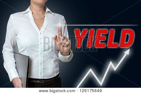 yield touchscreen is operated by businesswoman background