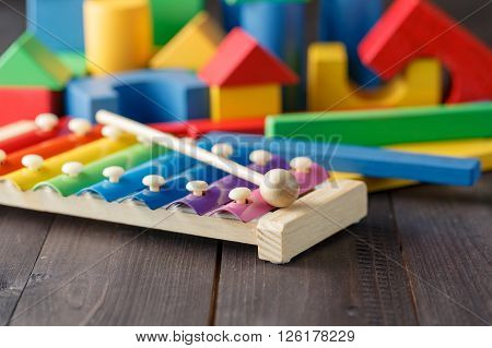Xylophone metallophone for kids selective focus on wooden floor