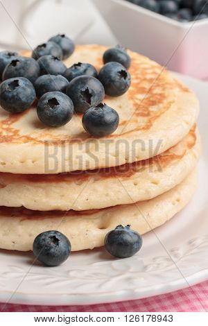 Buttermilk pancakes with blueberries in a bright breakfast setting