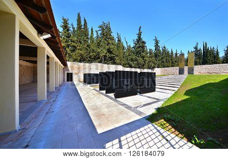 KAISARIANI GREECE, APRIL 4 2016: memorial at Kaisariani shooting range of 200 Greek communists, executed by the Nazi occupation authorities on 1st May 1944. The greek words are names of those people.