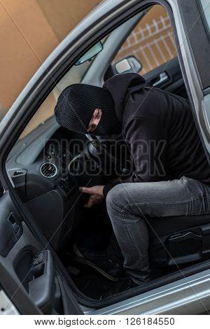 Car Thief  Trying To Run A Car.