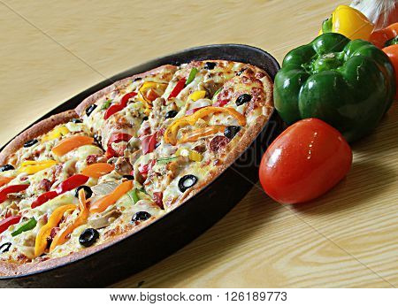Pizza with loads of extra cheese and extra topping