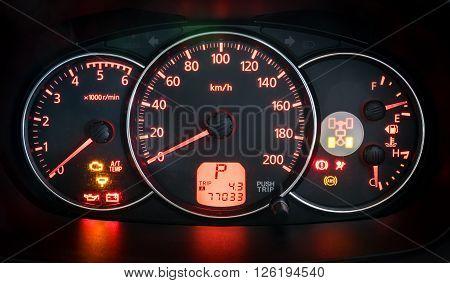 Modern car illuminated dashboard closeup, car dashboard