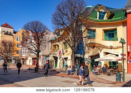 SOPOT, POLAND - APRIL 15, 2016: People on Monte Cassino street with many shops, clubs, galleries. Sopot is a very popular tourist resort in the country.