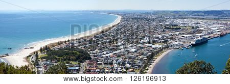 The panoramic view of Maunt Maunganui resort town from the top of Mount Maunganui volcano (Tauranga New Zealand).