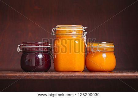 Jars of jam on a shelf