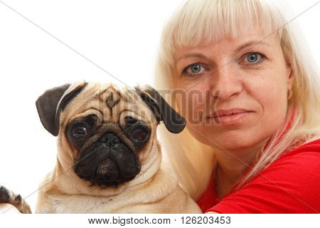 A woman and a pug facing the camera
