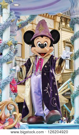 DISNEYLAND, PARIS, FRANCE - JUNE 29, 2014. Mickey Mouse dressed in The Sorceror's Apprentice clothes during the Disney Parade.