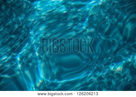 Ripple of water in the pool with sunny reflections summer time water waves