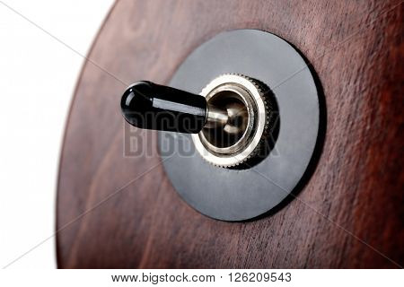 Toggle switch of brown electric guitar, close up