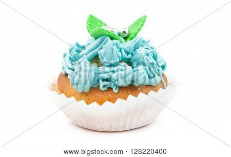 Teal birthday cupcake with butter cream icing isolated on white