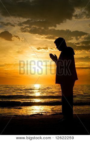Man Standing At The Ocean Praying