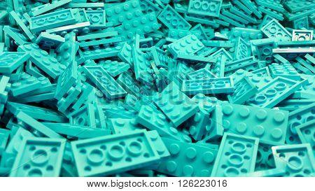 Many blue retangular plastic blocks piled together