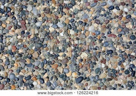 small stones in the concrete on the floor