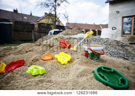 children toys on sand - yeallow red blue green