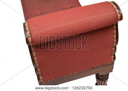 Cushioned Arm Of An Antique Wooden Daybed