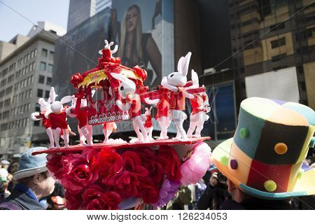 NEW YORK - MAR 27 2016: Close up of a bonnet made of toy rabbits carrying a Chinese jiao on 5th Avenue on Easter Sunday for the traditional Easter Bonnet Parade in Manhattan on March 27, 2016.