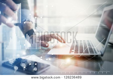Business concept photo.Businessman working stock exchange project modern office.Touching pad contemporary laptop. Worldwide connection technology, stock exchanges graphics interface.