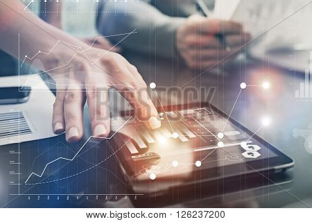 Closeup photo female hands touching screen modern tablet. Account managers working new investment project in office. Using electronic devices. Graphics icons, worldwide stock exchanges interface