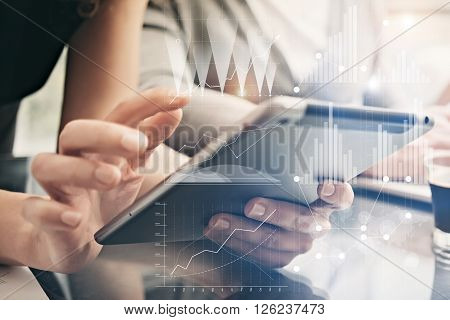 Closeup photo female hands holding modern tablet. Account managers working new private banking project office. Using electronic devices. Graphics icons, worldwide stock exchanges interface.