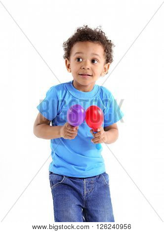 Little boy playing on maracas, isolated on white