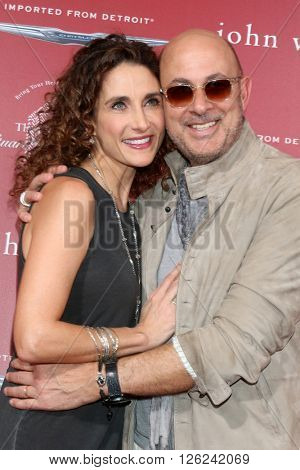 LAS VEGAS - APR 17:  Melina Kanakaredes, John Varvatos at the John Varvatos 13th Annual Stuart House Benefit at the John Varvatos Store on April 17, 2016 in West Hollywood, CA