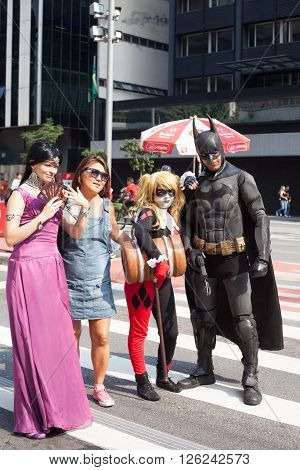 SAO PAULO SP/BRAZIL: APRIL 10 2016 - Cosplayers dressing as Batman and other characters walking at Avenida Paulista April 10, 2016 in Sao Paulo, Brazil.