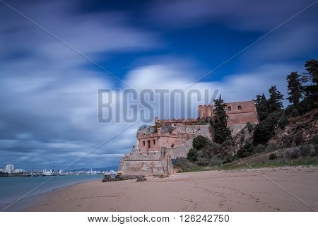 View of historical Castle of Sao Joao do Arade in Ferragudo, Portimao.  Portugal