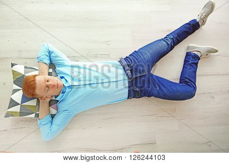 Young man sleeping on the floor